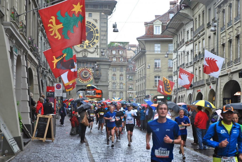 A group of runners along Bern's main street heading towards the finish.