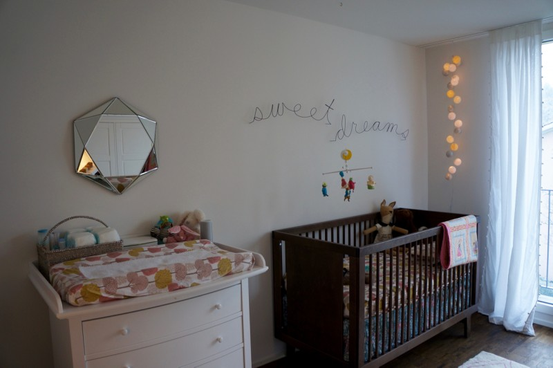 favorite lounging spots, the crib and on the changing pad