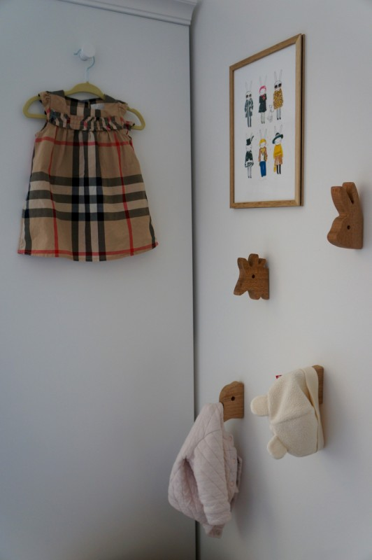 animal hooks and favorite gifted burberry dress on display